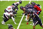 Houston Texans quarterback Deshaun Watson (4) takes a snap from center Nick Martin (66) during NFL football training camp Thursday, Aug. 27, 2020, in Houston. (Brett Coomer/Houston Chronicle via AP, Pool)