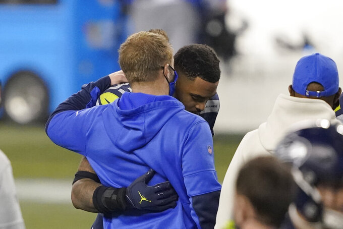 Seattle Seahawks strong safety Jamal Adams, right, greets Los Angeles Rams head coach Sean McVay after an NFL wild-card playoff football game, Saturday, Jan. 9, 2021, in Seattle. (AP Photo/Ted S. Warren)