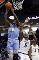 Columbia forward Ike Nweke, left, shoots against Northwestern center Dererk Pardon during the first half of an NCAA college basketball game Sunday, Dec. 30, 2018, in Evanston, Ill. (AP Photo/Nam Y. Huh)