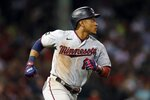 Minnesota Twins' Jorge Polanco runs on his two-run home run during the seventh inning of a baseball game against the Boston Red Sox, Tuesday, Aug. 24, 2021, in Boston. (AP Photo/Michael Dwyer)