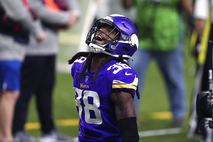 Minnesota Vikings cornerback Harrison Hand (38) celebrates his interception in the first half of an NFL football game against the New Orleans Saints in New Orleans, Friday, Dec. 25, 2020. (AP Photo/Butch Dill)
