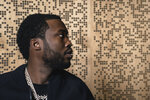 """This Dec. 4, 2019 photo shows Meek Mill posing for a portrait at Jungle City Studios in New York. Mill, born Robert Rihmeek Williams, is competing for a Grammy Award for best rap album with the platinum-seller """"Championships,"""" his passionate project detailing his life. (Photo by Christopher Smith/Invision/AP)"""