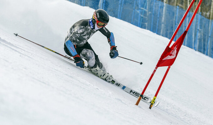 FILE - Max Bervy makes turns on the newly-opened Gold Peak Competition Center in Vail, Colo., in this Nov. 20, 2017, file photo. Two-time Olympic champion Ted Ligety was Bervy's idol growing up. The World Pro Ski Tour starts the season this weekend with a pair of races in Steamboat Springs, Colorado. The person you're competing against could be a national team member, World Cup competitor, college standout, journeyman or even two-time Olympic champion Ted Ligety, who's been known to make an appearance in the field. (Chris Dillmann/Vail Daily via AP, File)