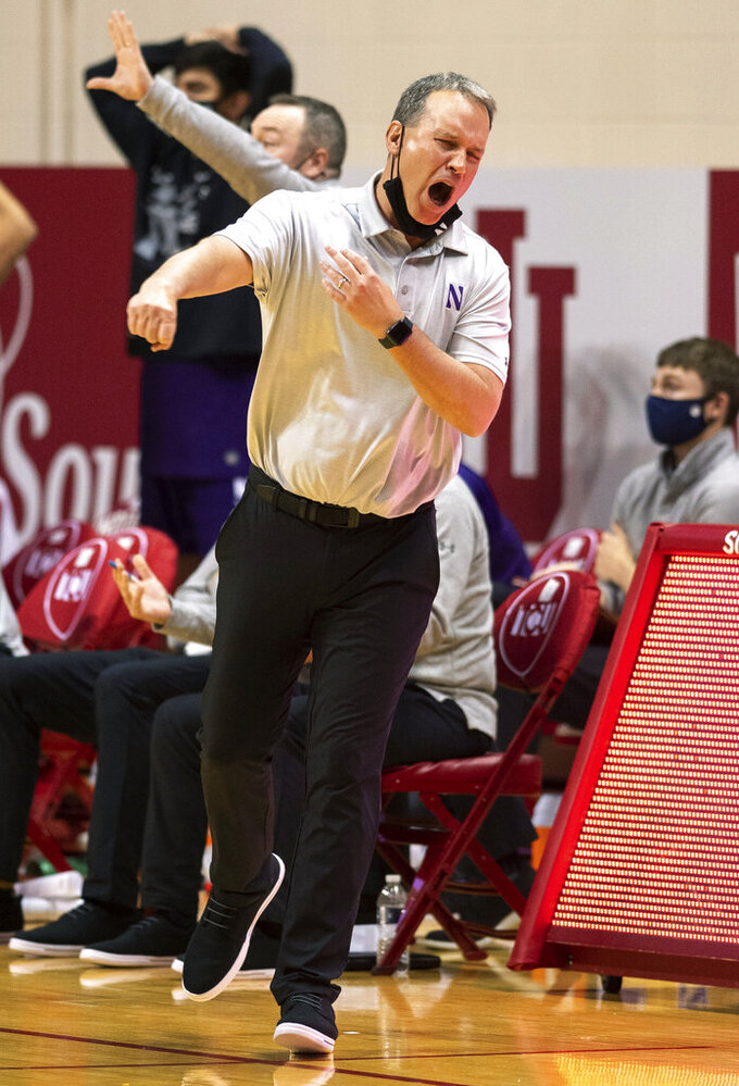 Northwestern coach Chris Collins reacts to a call during the second half of the team's NCAA college basketball game against Indiana, Wednesday, Dec. 23, 2020, in Bloomington, Ind. (AP Photo/Doug McSchooler)