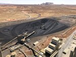 This Aug. 20, 2019, image shows the coal stockpile at the Navajo Generating Station near Page, Ariz. Before the end of the year, the power plant near the Arizona-Utah border will close and others in the region are on track to shut down or reduce their output in the next few years. (AP Photo/Susan Montoya Bryan)