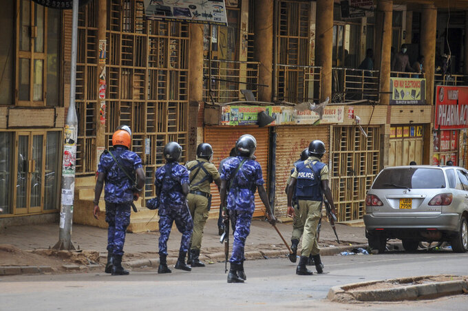 Ugandan security forces patrol on a street in Kampala, Uganda Thursday, Nov. 19, 2020. The death toll from protests over the latest arrest of Ugandan opposition presidential hopeful and musician Bobi Wine has risen to 16, police said Thursday, as a second day of demonstrations continued in the country's worst unrest in a decade. (AP Photo)