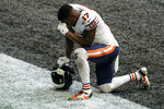 Chicago Bears wide receiver Anthony Miller (17) prays after an NFL football game against the Atlanta Falcons, Sunday, Sept. 27, 2020, in Atlanta. The Chicago Bears won 30-26. The entire Chicago Bears team had the initials of former player Gayle Sayers on their jerseys. (AP Photo/Brynn Anderson