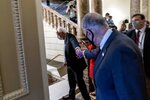 Sen. Bernie Sanders, I-Vt., left, and Senate Majority Leader Chuck Schumer of N.Y., right, shake hands as they walk out of a budget resolution meeting at the Capitol in Washington, Monday, Aug. 9, 2021. (AP Photo/Andrew Harnik)