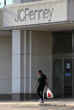 In this Wednesday, Aug. 14, 2019, photo photo a shopper leaves the JCPenney store in Peabody, Mass. J.C. Penney Co. on Thursday, Aug. 15, reported a loss of $48 million in its fiscal second quarter. (AP Photo/Charles Krupa)