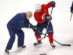 Florida Panthers head coach Joel Quenneville works with Panthers left wing Grigori Denisenko (14) during training camp in preparation for the 2021 NHL season Sunday, Jan. 10, 2021, in Sunrise, Fla. (David Santiago/Miami Herald via AP)