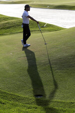 Abraham Ancer casts a shadow as he waits to hit on the seventh green during the second round of The Players Championship golf tournament Friday, March 15, 2019, in Ponte Vedra Beach, Fla. (AP Photo/Lynne Sladky)