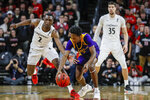 East Carolina's Tristen Newton, center, and Cincinnati's Keith Williams, left, battle for a loose ball during the first half of an NCAA college basketball game, Sunday, Jan. 19, 2020, in Cincinnati. (AP Photo/John Minchillo)