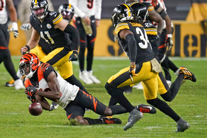 Cincinnati Bengals wide receiver A.J. Green (18) cannot hang onto a pass from quarterback Joe Burrow with Pittsburgh Steelers strong safety Terrell Edmunds (34) defending during the second half of an NFL football game, Sunday, Nov. 15, 2020, in Pittsburgh. (AP Photo/Keith Srakocic)