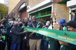Shawn Kemp, center, a former NBA basketball player for the Seattle SuperSonics and several other teams, cuts the grand-opening ribbon for Shawn Kemp's Cannabis, the marijuana dispensary he owns with several business partners, Friday, Oct. 30, 2020, in downtown Seattle. (AP Photo/Ted S. Warren)