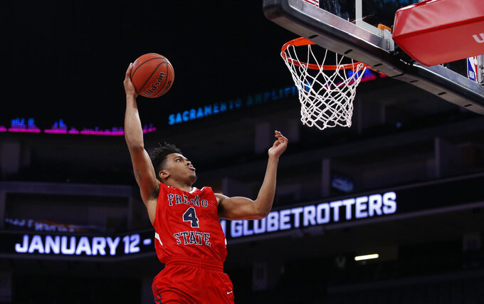 Fresno State's Niven Hart goes up for a dunk against Saint Mary's during the second half of an NCAA college basketball game in Sacramento, Calif., Wednesday, Nov. 20, 2019. Saint Mary's won 68-58. (AP Photo/Rich Pedroncelli)