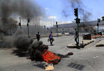 Protesters block a main highway by burning tires and garbage containers, during a protest against the increase in prices of consumer goods and the crash of the local currency, in Beirut, Lebanon, Thursday, June 17, 2021. Shops, government offices, businesses and banks shut their doors Thursday in response to a call for a general strike by Lebanon's main labor union. (AP Photo/Hussein Malla)