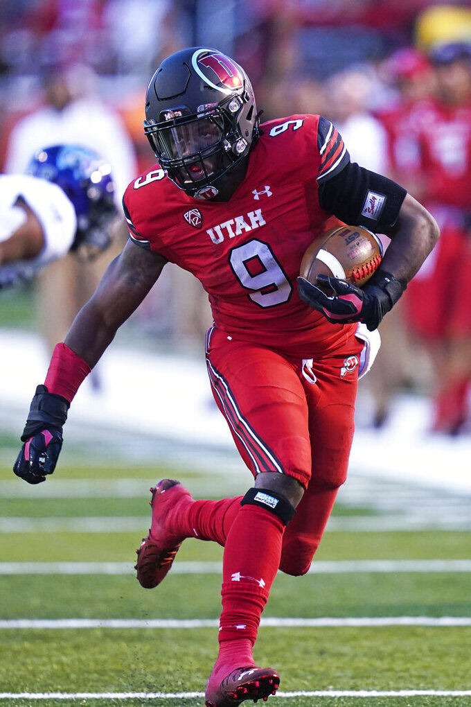 Utah running back Tavion Thomas carries the ball during the first half of the team's NCAA college football game against Weber State on Thursday, Sept. 2, 2021, in Salt Lake City. (AP Photo/Rick Bowmer)