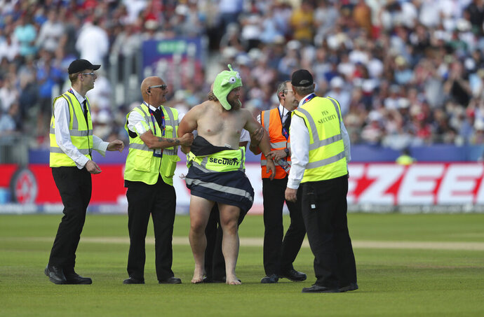A streaker runs into the field during the Cricket World Cup match between New Zealand and England in Chester-le-Street, England, Wednesday, July 3, 2019. (AP Photo/Scott Heppell)