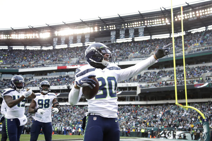 Seattle Seahawks' Bradley McDougald (30) celebrates after intercepting a Philadelphia Eagles' pass during the first half of an NFL football game, Sunday, Nov. 24, 2019, in Philadelphia. (AP Photo/Matt Rourke)