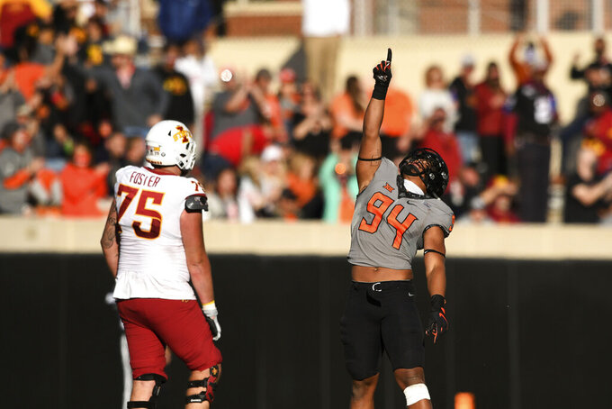 Iowa State offensive lineman Sean Foster (75) watches as Oklahoma State defensive end Trace Ford (94) celebrates following a defensive stop during the second half of an NCAA college football game Saturday, Oct. 24, 2020, in Stillwater, Okla. (AP Photo/Brody Schmidt)