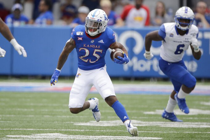 Kansas running back Dom Williams (25) runs for a first down during the second half of an NCAA college football game against Indiana State Saturday, Aug. 31, 2019, in Lawrence, Kan. Kansas won 24-17. (AP Photo/Charlie Riedel)