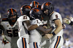 Oregon State wide receiver Tyjon Lindsey (1) celebrates his touchdown catch with teammates during the second half of an NCAA college football game against UCLA on Saturday, Oct. 5, 2019, in Pasadena, Calif. (AP Photo/Marcio Jose Sanchez)