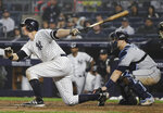 New York Yankees' DJ LeMahieu follows through on an RBI single during the fifth inning of a baseball game as Tampa Bay Rays catcher Mike Zunino watches, Tuesday, June 18, 2019, in New York. (AP Photo/Frank Franklin II)