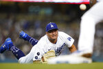 Los Angeles Dodgers relief pitcher Victor Gonzalez throws to first baseman Max Muncy, right, after fielding a ground ball hit by New York Mets' Brandon Nimmo during the fifth inning of a baseball game Thursday, Aug 19, 2021, in Los Angeles. (AP Photo/Ashley Landis)