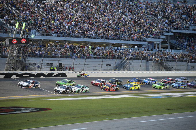 William Byron (24) takes the green flag at the start of a NASCAR Cup Series auto race at Daytona International Speedway, Saturday, Aug. 28, 2021, in Daytona Beach, Fla. (AP Photo/Phelan M. Ebenhack)