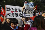 Pro-Beijing supporters hold up signs which reads