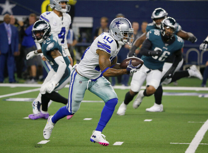 Dallas Cowboys' Tavon Austin sprints to the end zone for a touchdown in the first half of an NFL football game against the Philadelphia Eagles in Arlington, Texas, Oct. 20, 2019. (AP Photo/Michael Ainsworth)