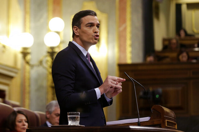 Spain's Socialist leader Pedro Sanchez addresses lawmakers during a parliamentary debate at the Spanish parliament in Madrid, Saturday, Jan. 4, 2020. Spain's interim Prime Minister Pedro Sánchez faces a parliamentary debate Saturday ahead of his attempt to form a coalition government for the eurozone's fourth-largest economy. (AP Photo/Andrea Comas)