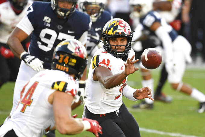 Maryland quarterback Taulia Tagovailoa (3) pitches the ball to Maryland running back Jake Funk (34) against Penn State in the first quarter of an NCAA college football game in State College, Pa., Saturday, Nov. 7, 2020. (AP Photo/Barry Reeger)