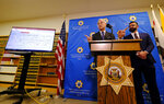 San Francisco District Attorney George Gascon, left, announces the implementation of an artificial intelligence tool to remove potential for bias in charging decisions as Alex Chohlas-Wood, Deputy Director, Stanford Computational Policy Lab, listens during a news conference Wednesday, June 12, 2019, in San Francisco. In a first-of-its kind experiment, San Francisco prosecutors are turning to artificial intelligence to reduce bias in the criminal courts.  (AP Photo/Eric Risberg)