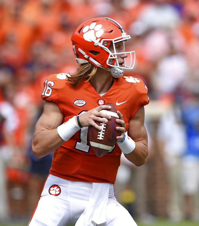 Clemson quarterback Trevor Lawrence drops back to pass during the first half of an NCAA college football game against Syracuse, Saturday, Sept. 29, 2018, in Clemson, S.C. Clemson won 27-23. (AP Photo/Richard Shiro)