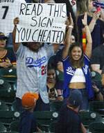 Los Angeles Dodgers fans taunt the Houston Astros before a game, Tuesday, May 25, 2021 at Minute Maid Park in Houston. (Kevin M. Cox/The Galveston County Daily News via AP)