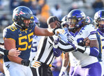 TCU defensive end Ochaun Mathis (32) and West Virginia  offensive lineman Parker Moorer (55) shoving after the whistle during the second half of an NCAA college football game on Saturday, Nov. 14, 2020, in Morgantown, W.Va. (William Wotring/The Dominion-Post via AP)