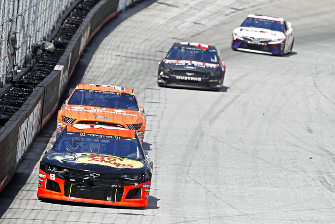 Driver Daniel Hemric (8) leads David Ragan others down the back straight during practice for a NASCAR Cup Series auto race, Friday, Aug. 16, 2019, in Bristol, Tenn. (AP Photo/Wade Payne)