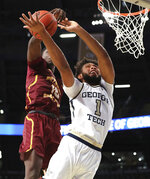 Georgia Tech forward James Banks III (1) goes to the basket as Bethune-Cookman forward Cletrell Pope blocks the shot during an NCAA college basketball game Sunday, Dec. 1, 2019, in Atlanta. (Curtis Compton/Atlanta Journal-Constitution via AP)