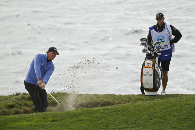 Phil Mickelson chips the ball out of a bunker up to the seventh green of the Pebble Beach Golf Links during the third round of the AT&T Pebble Beach National Pro-Am golf tournament Saturday, Feb. 8, 2020, in Pebble Beach, Calif. (AP Photo/Eric Risberg)
