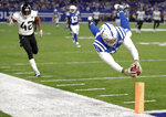 Indianapolis Colts tight end Eric Ebron, right, dives for a touchdown in front of Jacksonville Jaguars strong safety Barry Church (42) during the first half of an NFL football game in Indianapolis, Sunday, Nov. 11, 2018. (AP Photo/Michael Conroy)