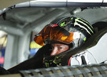Kurt Busch waits in his car while crew members make adjustments in his garage during a NASCAR auto racing practice session at Daytona International Speedway, Saturday, Feb. 10, 2018, in Daytona Beach, Fla. (AP Photo/John Raoux)