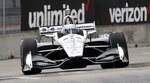 Simon Pagenaud, of France, drives through the second turn during a practice session for the first race of the IndyCar Detroit Grand Prix auto racing doubleheader, Friday, May 31, 2019, in Detroit. (AP Photo/Carlos Osorio)