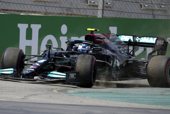 Mercedes driver Valtteri Bottas of Finland goes off the track during the first free practice for the Spanish Formula One Grand Prix at the Barcelona Catalunya racetrack in Montmelo, just outside Barcelona, Spain, Friday, May 7, 2021. The Spanish Grand Prix will be held on Sunday. (AP Photo/Emilio Morenatti)