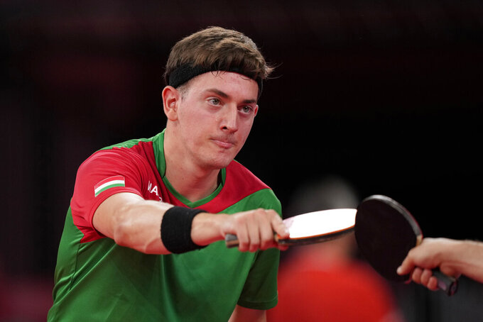 Hungary's Bence Majoros reacts after the table tennis men's singles first round match against Algeria's Larbi Bouriah at the 2020 Summer Olympics, Saturday, July 24, 2021, in Tokyo. (AP Photo/Kin Cheung)