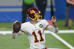 Washington Football Team quarterback Alex Smith looks to throw during the first half of an NFL football game against the Detroit Lions, Sunday, Nov. 15, 2020, in Detroit. (AP Photo/Tony Ding)