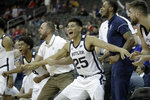 The Butler bench celebrates after a basket during the second half of an NCAA college basketball game against Stanford Tuesday, Nov. 26, 2019, in Kansas City, Mo. Butler won 68-67. (AP Photo/Charlie Riedel)