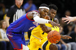 DePaul forward Paul Reed (4) grabs a loose ball ahead of Iowa guard Joe Toussaint during the second half of an NCAA college basketball game, Monday, Nov. 11, 2019, in Iowa City, Iowa. DePaul won 93-78. (AP Photo/Charlie Neibergall)