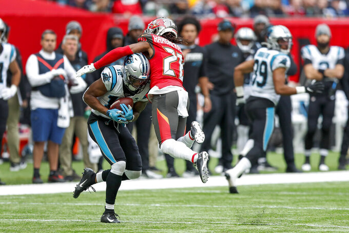 Carolina Panthers wide receiver D.J. Moore (12) makes a catch against Tampa Bay Buccaneers cornerback Vernon III Hargreaves (28) during the second quarter of an NFL football game, Sunday, Oct. 13, 2019, at Tottenham Hotspur Stadium in London. (AP Photo/Alastair Grant)