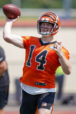 Cincinnati Bengal quarterback Andy Dalton (14) throws a pass during the first day of NFL football training camp Saturday, July 27, 2019, in Dayton, Ohio. (AP Photo/Bryan Woolston)